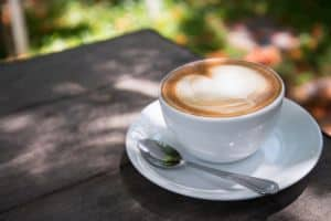 white-ceramic-cup-filled-with-latte-1036445